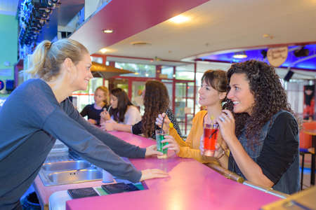 barmaid and her friends Stock Photo