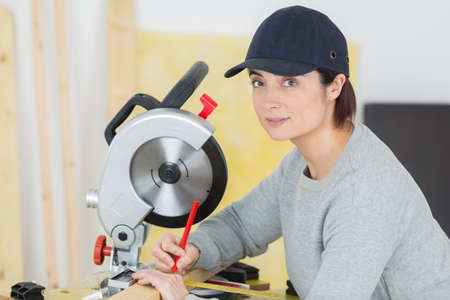 female working at table in workshop