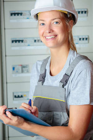 dungarees: Portrait of female manual worker Stock Photo