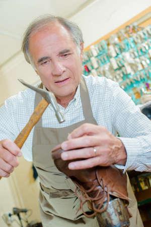 Cobbler repairing a sole