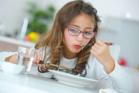 Young girl eating Stock Photo