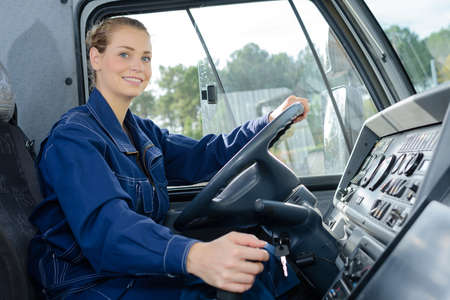 Woman in driving seat of heavy goods vehicle Stok Fotoğraf