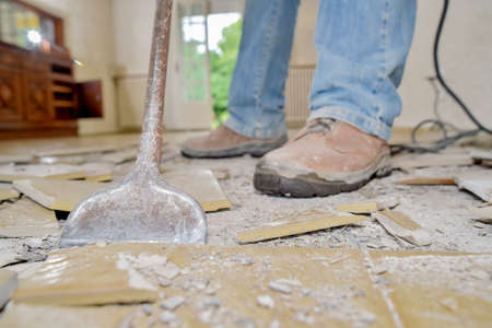Removing old floor tiles 스톡 콘텐츠