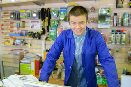 shopkeeper: Portrait of young shopkeeper