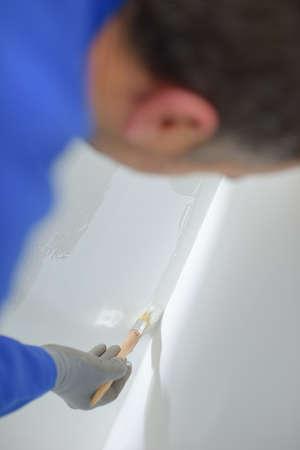 Closeup of man painting Stock Photo