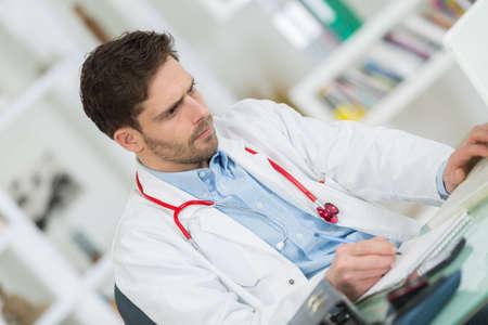 sickbed: handsome doctor at work