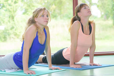 two women doing yoga Stock Photo