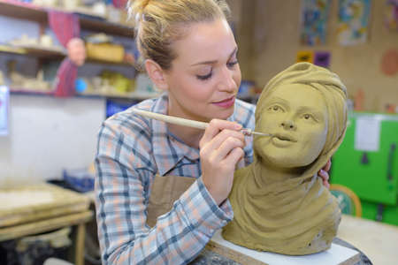 combines: woman doings some artistic details