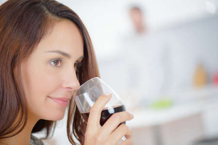 Lady appreciating the bouquet of red wine Stock Photo