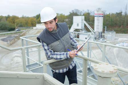 Man on platform of construction site