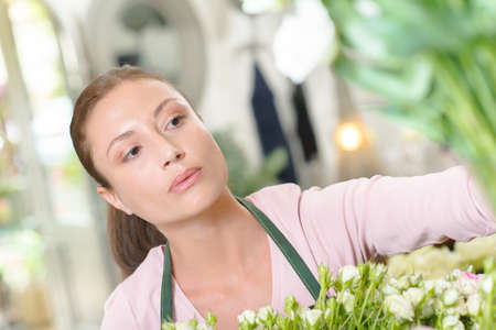 one female: Female florist, looking to one side