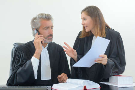 insist: Legal workers in robes Stock Photo