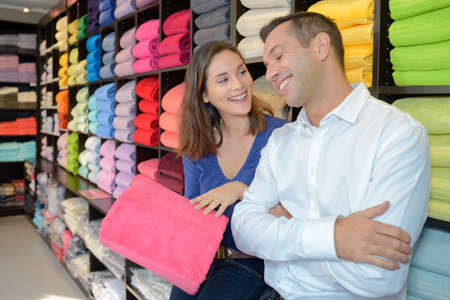 Couple choosing colored towels