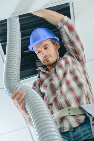 Electrician working in a ceiling