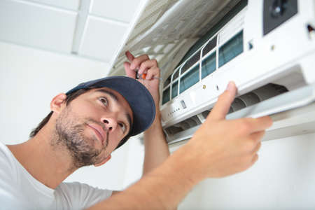 cleaning an airconditioning Stock Photo - 77590181