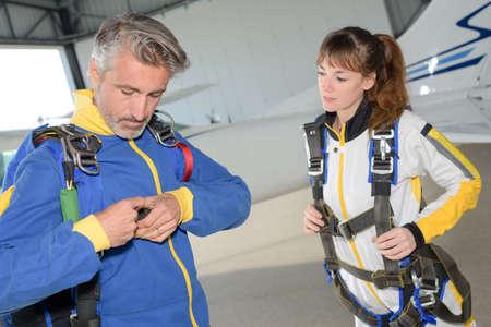 parachutists: Parachutists securing harness Stock Photo