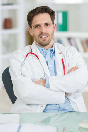 handsome young doctor at work in his office