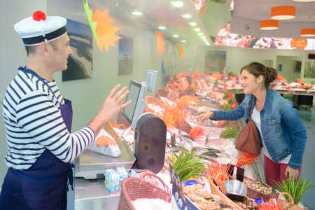 seafood vendor and customer
