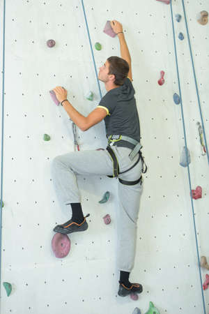 overhang: young man wall climbing Stock Photo
