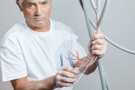 Electrician preparing some wiring Stock Photo