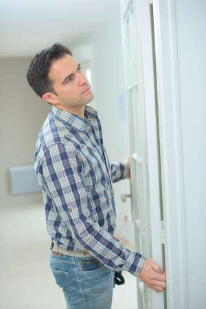 Man fitting interior door Stock Photo