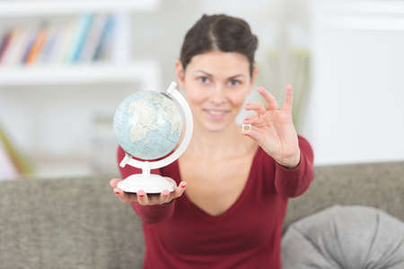 portrait of lady holding globe and sim card