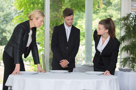 hotel staff: full length portrait of confident restaurant staff Stock Photo