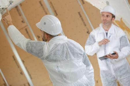 building regulations: Workmen inspecting site