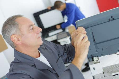 appliance: Technician woking on appliance Stock Photo