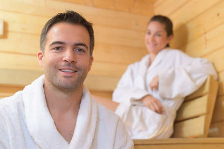 toweling: Portrait of couple in sauna Stock Photo