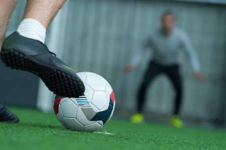 soccer player ready to shoot penalty