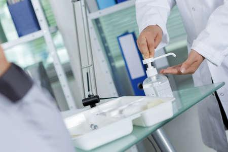 bactericidal: cropped image of surgeon using handwash in hospital Stock Photo