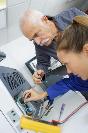 appliance: Technicians repairing electrical appliance