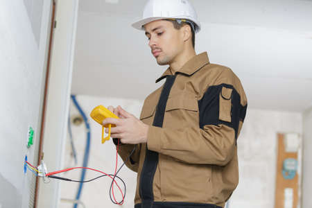 young engineer using a digital multimeter Stock Photo