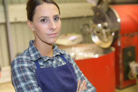 Portrait of woman in factory Stock Photo