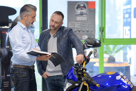 Salesman informing client about motorcycle