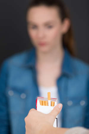 sway: offering a cigarette Stock Photo