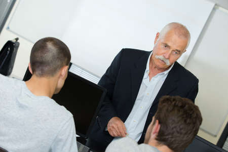 lecturing hall: professor with students