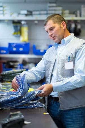 organise: Man sorting stock