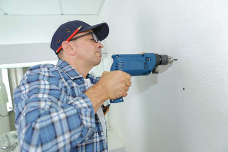 cabinetry: using a cordless drill Stock Photo