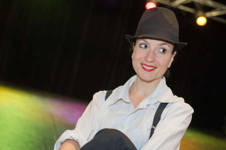 Lady on stage wearing a hat Stock Photo