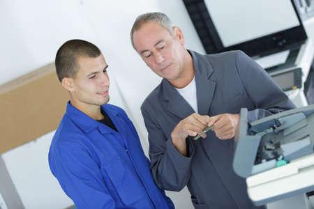 Apprentice technician listening to teacher