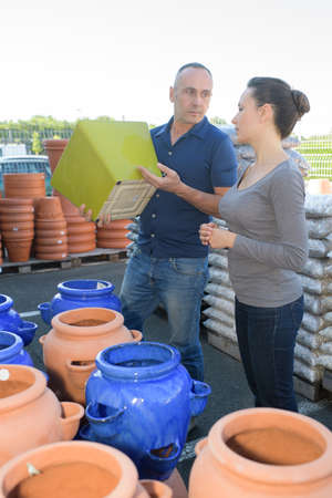plant pots: Couple choosing large plant pots