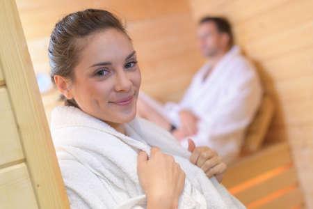 Woman in robe in doorway of sauna Reklamní fotografie - 78539498