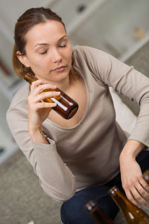 woman drinking alcoholic drink Stock Photo