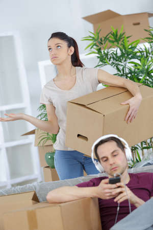 Frustrated woman with idle boyfriend Stock Photo