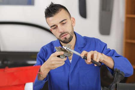 automobile door: Mechanic working on car part