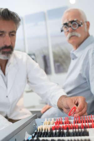 oap: Optician testing sight of senior citizen