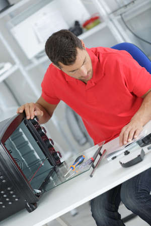 Technician working on counter top oven Stock Photo