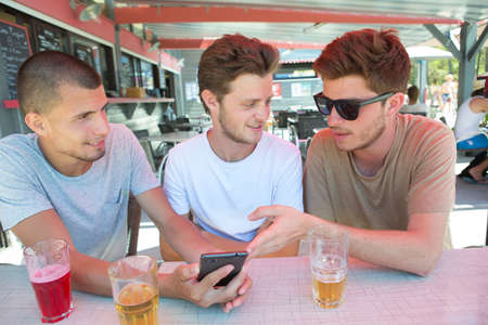 nominated: Three young lads at the bar Stock Photo